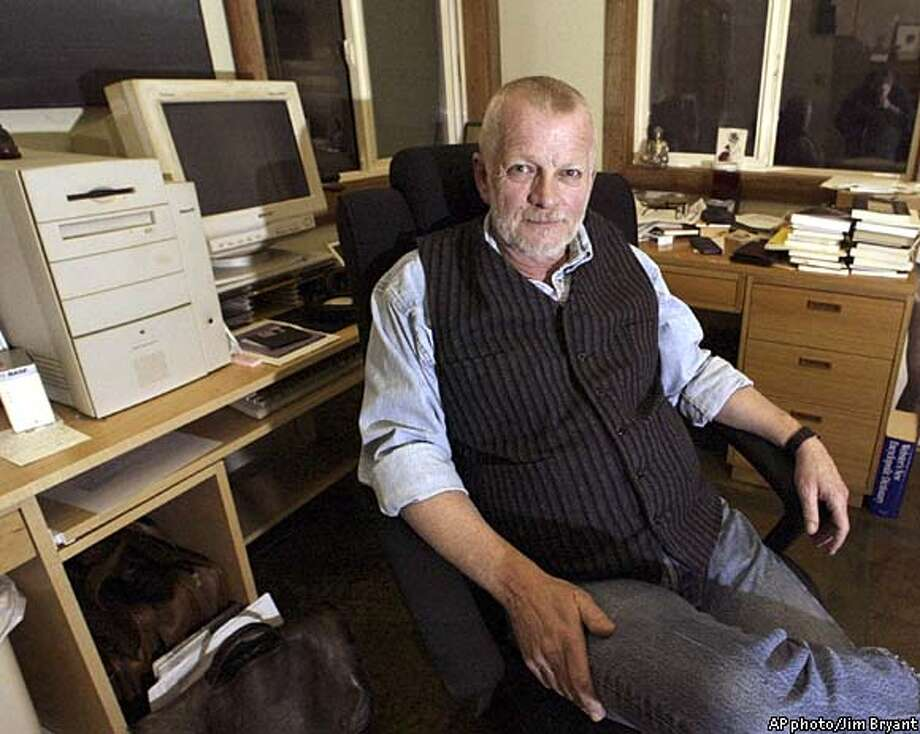 Sam Hamill, editor of the prestigious Copper Caynon Press, sits in his home office, Thursday, Jan. 30, 2003, in Port Townsend, Wash. The White House Symposium on Poetry and the American Voice was cancelled Wednesday after it was believed the event would be politicized. Hamill e-mailed friends asking for poems or statements opposing military action against Iraq. He had expected about 50 responses; hes gotten about 2,000, including contributions from W.S. Merwin, Adrienne Rich and Lawrence Ferlinghetti.(AP photo/Jim Bryant) Photo: JIM BRYANT