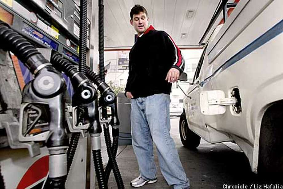 Travis Grooms, a construction worker from Alameda, getting just enough gas to get him over the bridge--$4 dollars worth--because he knows he can get it cheaper near home. He is at a 76 station on Divisidero at Fell streets. (PHOTOGRAPHED BY LIZ HAFALIA/THE SAN FRANCISCO CHRONICLE) Photo: LIZ HAFALIA