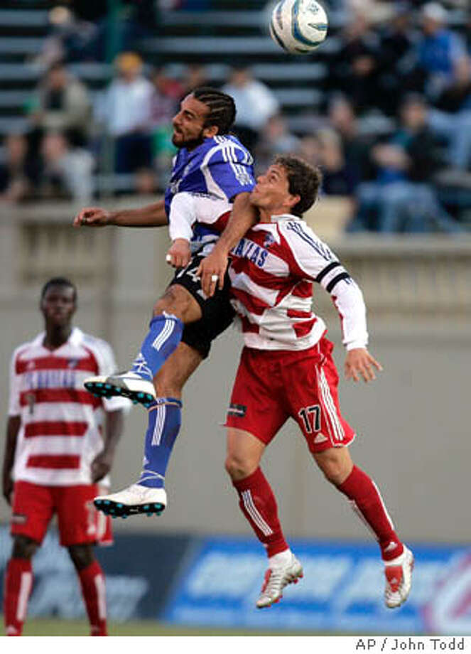 Dwayne De Rosario (left) and Dallas' Simo Valakari use their heads during the first half. Associated Press photo by John Todd