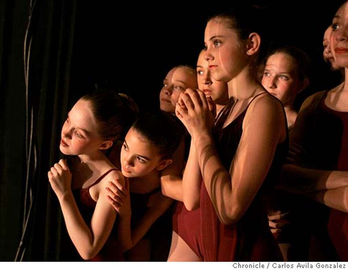SHOWCASE_003_CAG.JPG Students in Group III watch the performance of Group II before they go on stage during the Students Showcase from the San Francisco Ballet School of Dance at the Palace of Fine Arts Theater in San Francisco, Ca., on Wednesday, May 11, 2005. The kids range in age from 7-17, and perform for a crowd of about three thousand. Photo by Carlos Avila Gonzalez / The San Francisco Chronicle Photo taken on 5/11/05 in San Francisco, CA. MANDATORY CREDIT FOR PHOTOG AND SAN FRANCISCO CHRONICLE/ -MAGS OUT