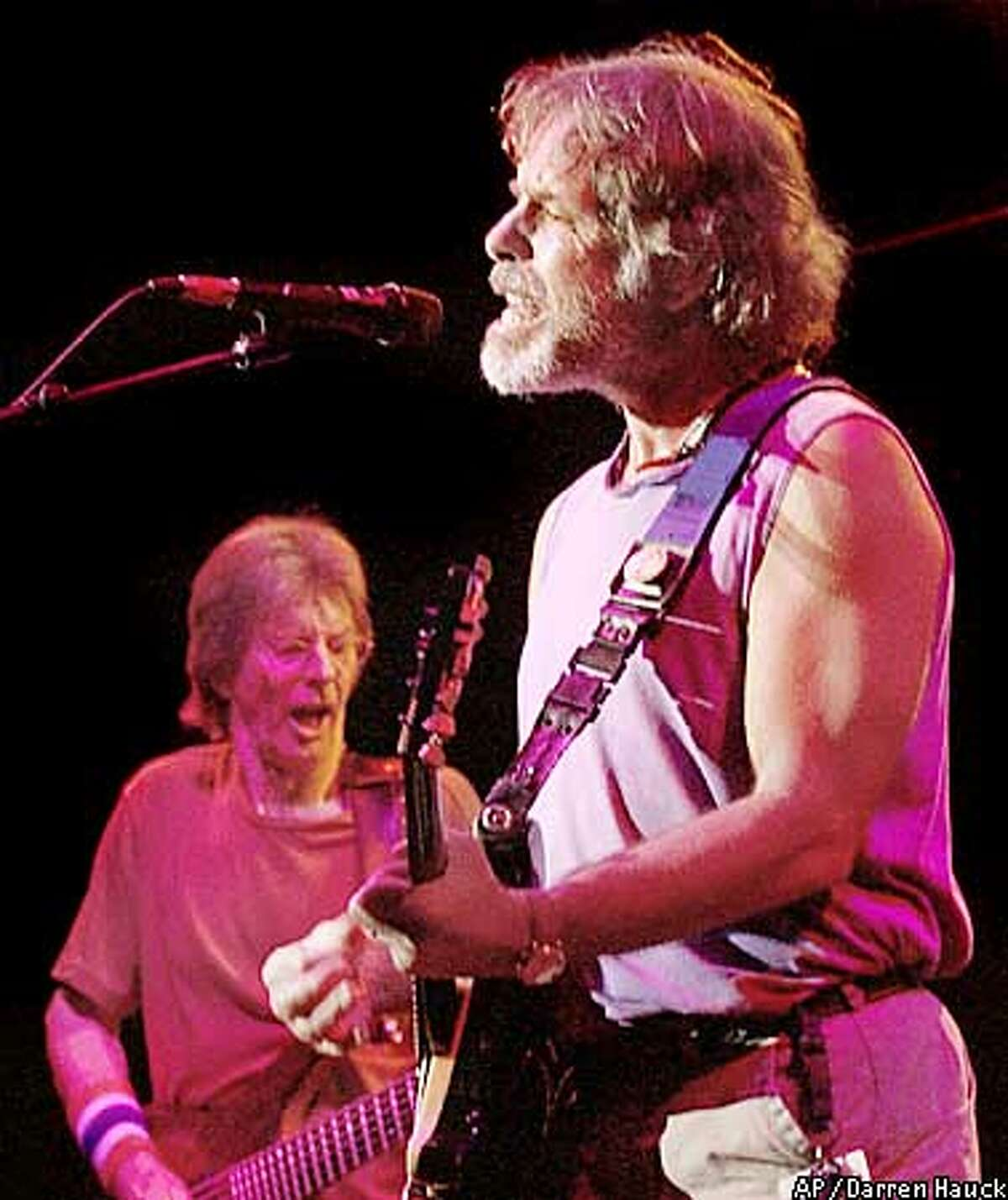 """** FILE ** Bob Weir, right, and Phil Lesh, left, are shown performing in East Troy, Wis., in this Aug. 4, 2002, file photo. Weir, Lesh and fellow former Grateful Dead band members Bill Kreutzman and Mickey Hart renamed themselves The Other Ones after the death of lead guitarist Jerry Garcia. Now they have decided to rename the band once again, this time calling themselves, simply, The Dead. """"With the greatest possible respect to our collective history, we have decided to keep the name 'Grateful Dead' retired in honor of Jerry's memory, and call ourselves: 'The Dead',"""" the band said. (AP Photo/ Darren Hauck, File)"""