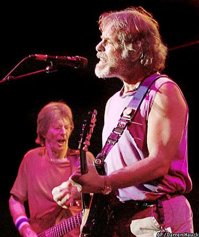 "** FILE ** Bob Weir, right, and Phil Lesh, left, are shown performing in East Troy, Wis., in this Aug. 4, 2002, file photo. Weir, Lesh and fellow former Grateful Dead band members Bill Kreutzman and Mickey Hart renamed themselves The Other Ones after the death of lead guitarist Jerry Garcia. Now they have decided to rename the band once again, this time calling themselves, simply, The Dead. ""With the greatest possible respect to our collective history, we have decided to keep the name 'Grateful Dead' retired in honor of Jerry's memory, and call ourselves: 'The Dead',"" the band said. (AP Photo/ Darren Hauck, File) Photo: DARREN HAUCK"
