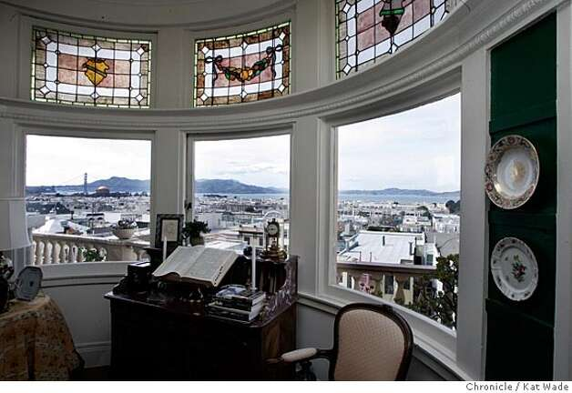 On 4/26/05 in San Francisco Millicent Susens (CQ) shows of the living room and dining room with a view of the golden gate bridge and palace of fine arts, that was designed by architect James Frances Dunn, who use intricate mouldings, arches and stained glass windows throughout the apartment building. Kat Wade/ The Chronicle Photo: Kat Wade