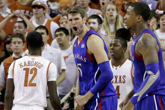 Kansas' Jeff Withey, center, reacts after he was fouled while scoring in the final seconds of the second half of an NCAA college basketball game against Texas, Saturday, Jan. 21, 2012, in Austin, Texas. Kansas won 69-66.  (AP Photo/Eric Gay)