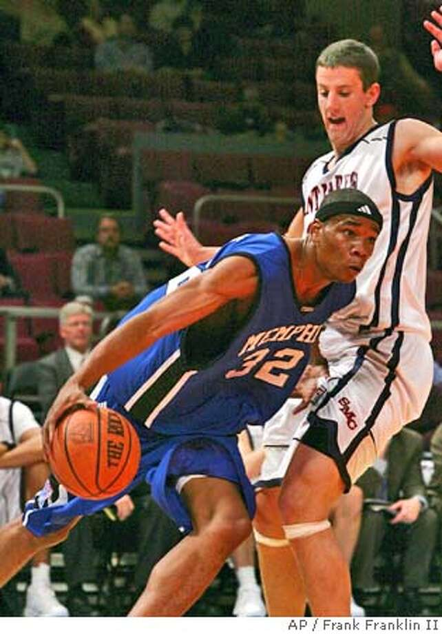 Memphis forward Sean Banks (32) drives past St. Mary's Daniel Kickert (14) in the first half of the semifinal round of the 2004 'Coaches vs. Cancer Classic' at New York's Madison Square Garden Thursday, Nov. 18, 2004. (AP Photo/Frank Franklin II) Sports#Sports#Chronicle#11/19/2004#ALL#5star##0422474205 Photo: FRANK FRANKLIN II