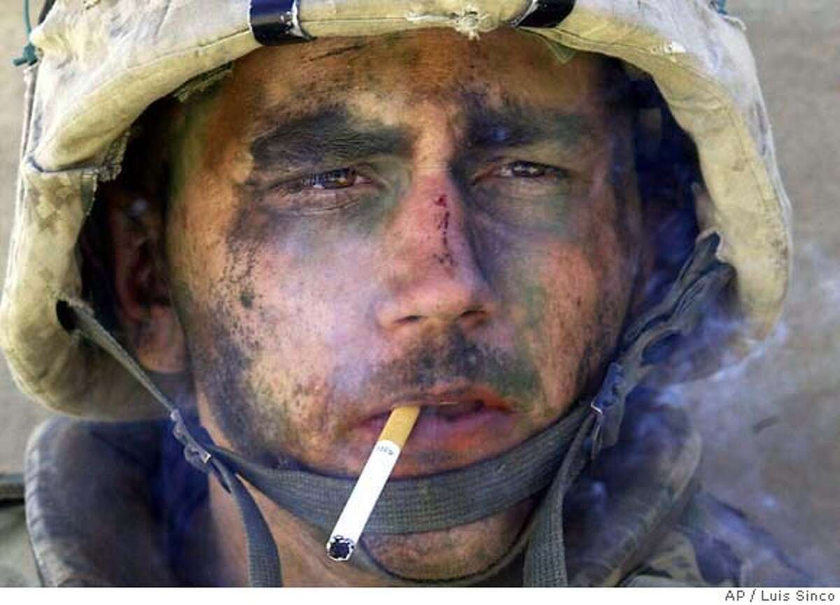 A member of Charlie Company of the U.S. Marines First Division, Eighth regiment, smokes a cigarette in Fallujah, Iraq, Tuesday, Nov. 9, 2004. U.S. forces punched into the center of the insurgent stronghold, overwhelming bands of guerrillas in the street with heavy barrages of fire and searching house to house in a powerful advance on the second day of a major offensive. (AP Photo/Los Angeles Times, Luis Sinco) ** MANDATORY CREDIT, , NO FOREIGN, NO MAGS, LOS ANGELES DAILY NEWS OUT, OC REGISTEROUT, VENTURA COUNTY STAR OUT, INLAND VALLEY DAILY BULLETIN OUT, SAN BERNARDINO SUN OUT **