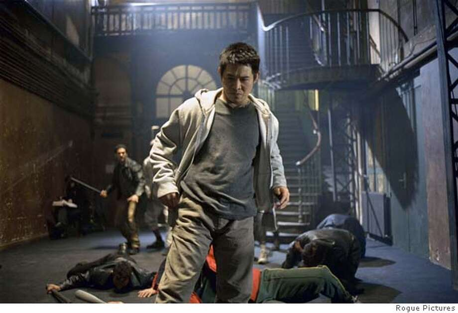 """In this photo provided by Rogue Pictures, Jet Li stars as Danny, a slave who has lived his whole life without any sort of normal human education, with only one lesson learned: how to fight in """"Unleashed."""" (Rogue Pictures)"""