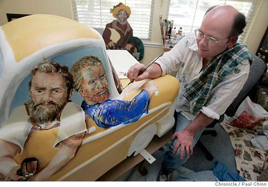 """Artist Mark Edwards works on his piece """"Art in Petaluma or Bust"""", which features images of Michelangelo and Vincent Van Gogh, on 4/29/05 in Petaluma, Calif. Several artists have transformed miniature vintage cruiser car casts into public showpieces as part of """"Cruisin' the Boulevard,"""" Petaluma's community public art exposition. The finished creations will be unveiled May 21 on """"Cruisin' the Boulevard Day"""" and will then be displayed around town throughout the summer before being sold.  PAUL CHINN/The Chronicle Photo: PAUL CHINN"""