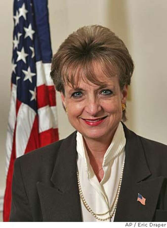 This photo released by the White House, shows the official portrait of Harriet Miers named by President Bush on Wednesday, Nov. 17, 2004, as White House counsel. Miers succeeds Alberto Gonzales, nominated by the president to be attorney general. (AP Photo/White House, Eric Draper) PHOTO RELEASED BY THE WHITE HOUSE Nation#MainNews#Chronicle#11/18/2004#ALL#5star#a4#0422472091 Photo: ERIC DRAPER