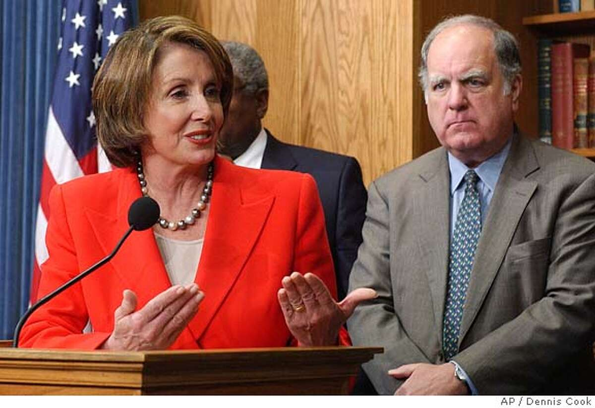 House Minority Leader Nancy Pelosi, D-Calif., talks to reporters on Capitol Hill Wednesday, Nov. 17, 2004, after a Democratic caucus re-elected her to the post. At right is Rep. John Spratt, D-S.C. (AP Photo/Dennis Cook) Nation#MainNews#Chronicle#11/18/2004#ALL#5star#a3#0422471825
