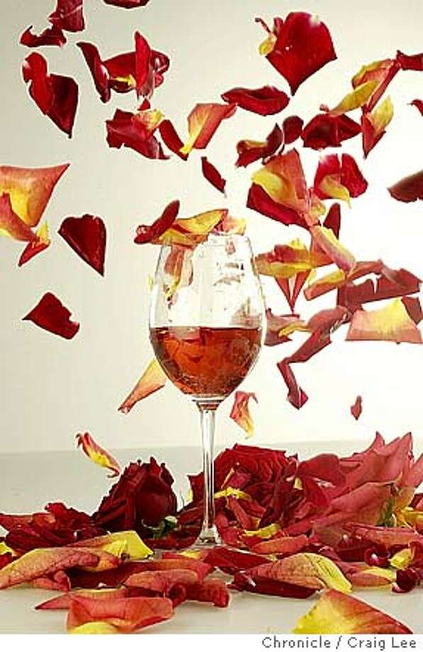 ROSE06127_cl.jpg  Photo illustration on rose wine. Photo of rose petals falling around a wine glass of pink wine. Food styled by Amanda Berne.  Event on 4/30/04 in San Francisco. Craig Lee / The Chronicle MANDATORY CREDIT FOR PHOTOG AND SF CHRONICLE/ -MAGS OUT Wine#Wine#Chronicle#11/18/2004#ALL#Advance##0421746650 Photo: Craig Lee