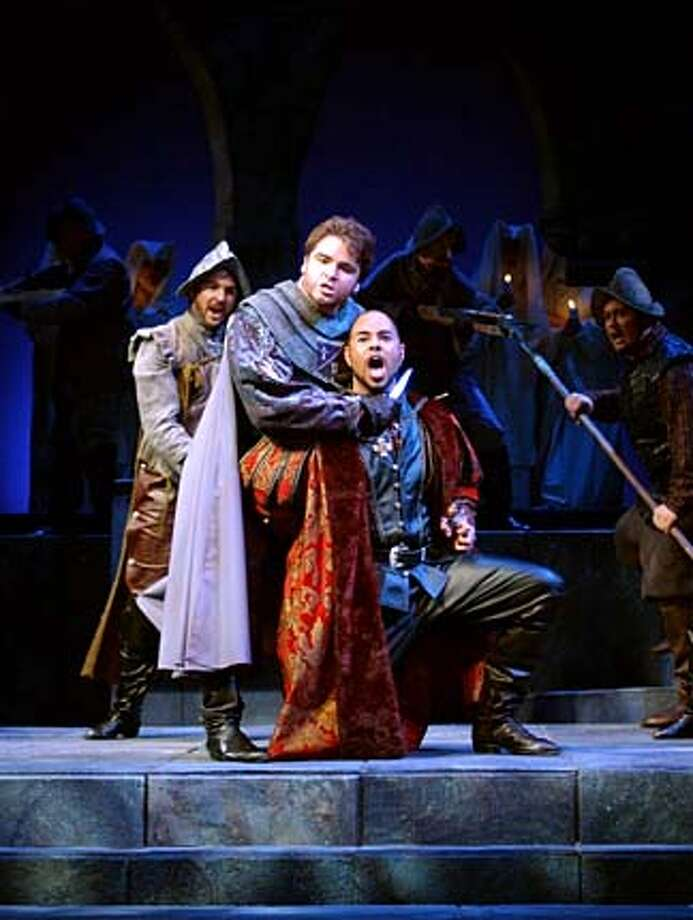 Opera San Jose  Bill Welch as Ruiz, Adam Flowers as Manrico (center  with knife), Joseph Wright as Count Di Luna (right, kneeling) HANDOUT PHOTO/VERIFY RIGHTS AND USEAGE Photo: HANDOUT