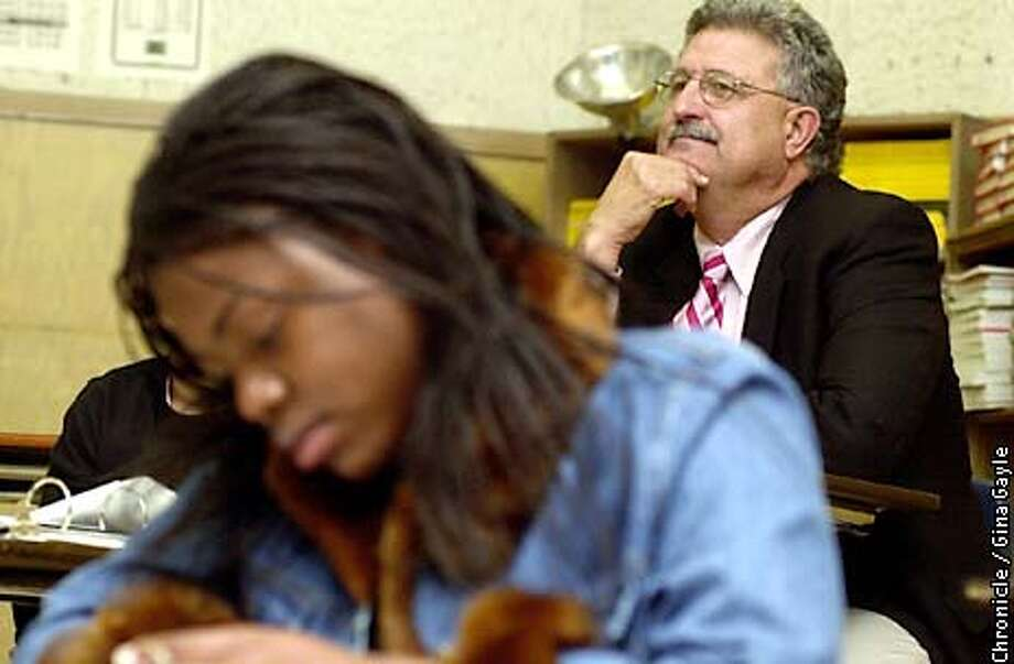 "Oakland School Superintendent Dennis Chaconas sits in a class with 10th-grade student, Genesis Ramos working in foreground, at Oakland Tech High. The Class, World History English I, taught by Ms. Joe was created by Mr. Chaconas and Ms. Joe. Mr. Chaconas is very hands on in visiting not only the eight schools that report directly to him, but all of them. Mr. Chaconas says that ""when I have tough days I gravitate to where I was happy"" remarking about his six years of being principal at Oakland Tech High. (NAME OF STUDENT IN FRONT TO COME LATER) Photo by Gina Gayle/The SF Chronicle. Photo: Gina Gayle"