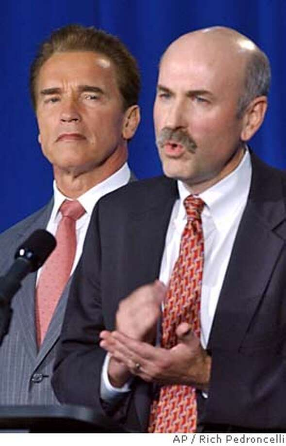 Gov. Arnold Schwarzenegger, left, listens as attorney Richard B. Ulmer, Jr., discusses the settlement in a lawsuit between Ulmer's client and the California Youth Authority during a news conference held at the N.A. Chaderjian Youth Correctional Facility in Stockton, Calif., Tuesday, Nov. 16, 2004. Under the terms of the settlement, filed against the CYA, and it's director, Walter Allen, III, the agency promises several reforms to correct a series of problems outlined in several national reports on theCYA. The settlement came out of taxpayer lawsuit filed by Margaret Farrell, who is a mother of a ward of the CYA, the Prison Law Office and the Disabilites Rights Advocates. (AP Photo/Rich Pedroncelli) Metro#MainNews#Chronicle#11/17/2004#ALL#5star##0422470341 Photo: RICH PEDRONCELLI