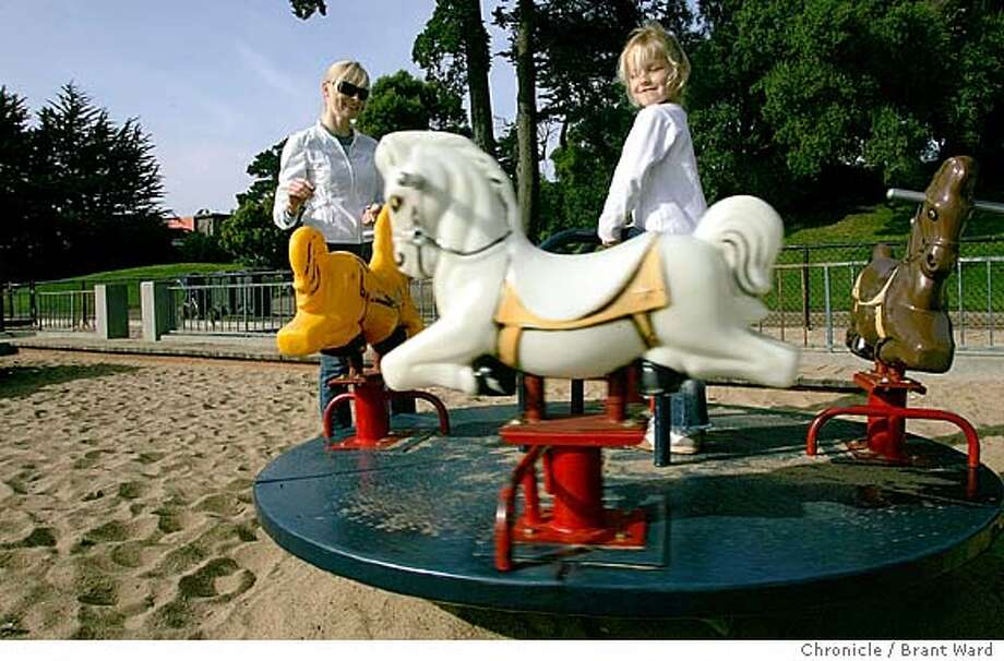 Sofie enjoyed the carousel at Alta Plaza Park with her mother...plans call for the entire playground to be modernized.  Alta Plaza Park in San Francisco's Pacific Heights district is undergoing a renovation with immediate attention on the tennis courts and children's playground. 11/15/04 Brant Ward Photo: Brant Ward
