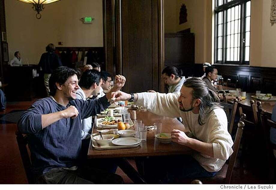 from left Brad Zamft, resident from New York; and Nick Sarbu, resident from Romania share a laugh and conversation during lunch in the Dining Commons at the International House. UC Berkeley's International House is marking its 75th annniversary. Created at a time when racism was rampant in the US and in the Bay Area, the IH has been home to 60,000 students over the years. Residents say the IH is a place where students from many cultures can, if not bridge their differences, then at least argue them civilly over a drink. -- A good contact at the house is Andrei Roth, a business student, 408-674-4681. He'll be around from 12-4 but out of the house after that.-- The house director is Joe Lurie, 510-642-9468.  The story will focus on the anniversary and include comments from Roth and other students.  Event on 11/10/04 in Berkeley. Lea Suzuki / The Chronicle Photo: Lea Suzuki