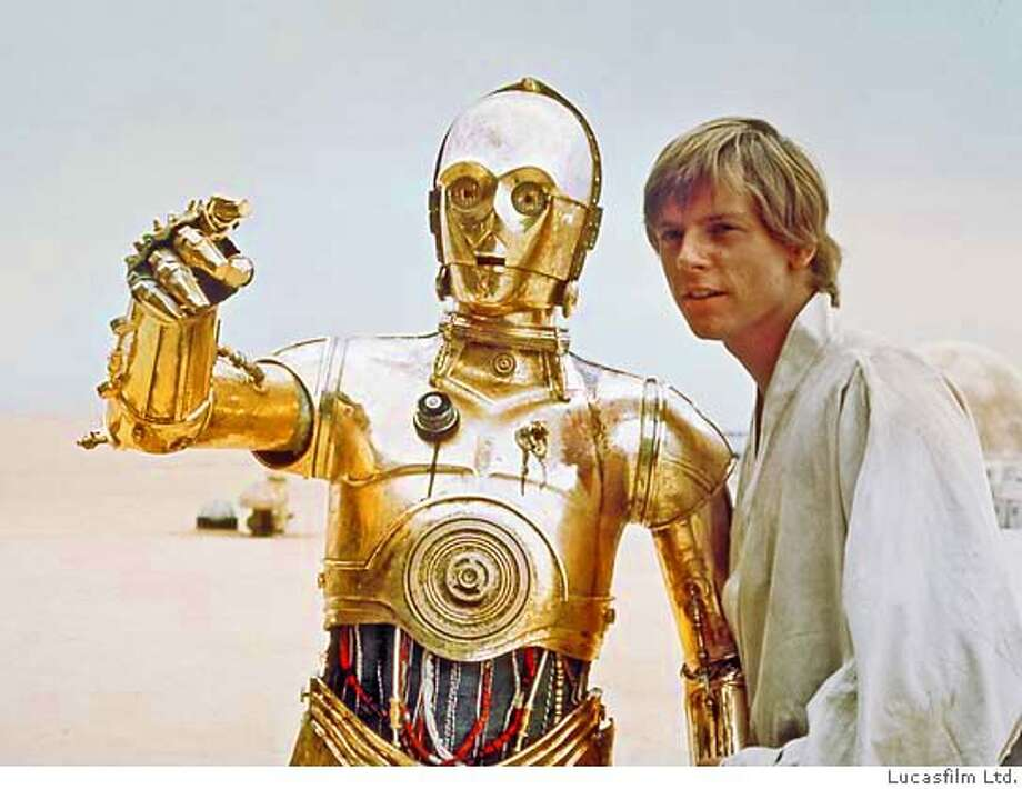 "** FILE **In this photo provided by Lucasfilm, Mark Hamill, right, portrays the character Luke Skywalker in this scene from the initial ""Star Wars"" release, with the droll droid C-3PO in this undated photo released in 2004 by Lucasfilm Ltd. (AP Photo/Copyright 2004 Lucasfilm Ltd. & TM. All rights reserved.) MANDATORY CREDIT: COPYRIGHT 2004 LUCASFILM LTD. & TM. ALL RIGHTS RESERVED UNDATED HANDOUT"