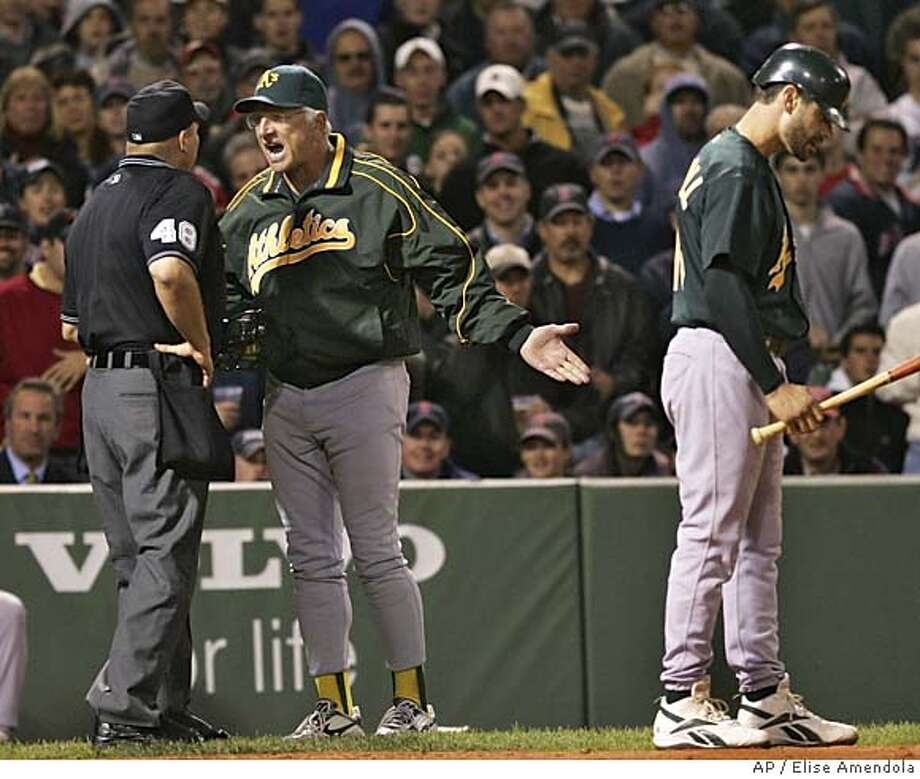 Oakland Athletics manager Ken Macha argues with home plate umpire Mark Carlson (48) as Jason Kendall, right, steps away in the seventh inning against the Boston Red Sox at Fenway Park in Boston Monday, May 9, 2005. (AP Photo/Elise Amendola) Photo: ELISE AMENDOLA