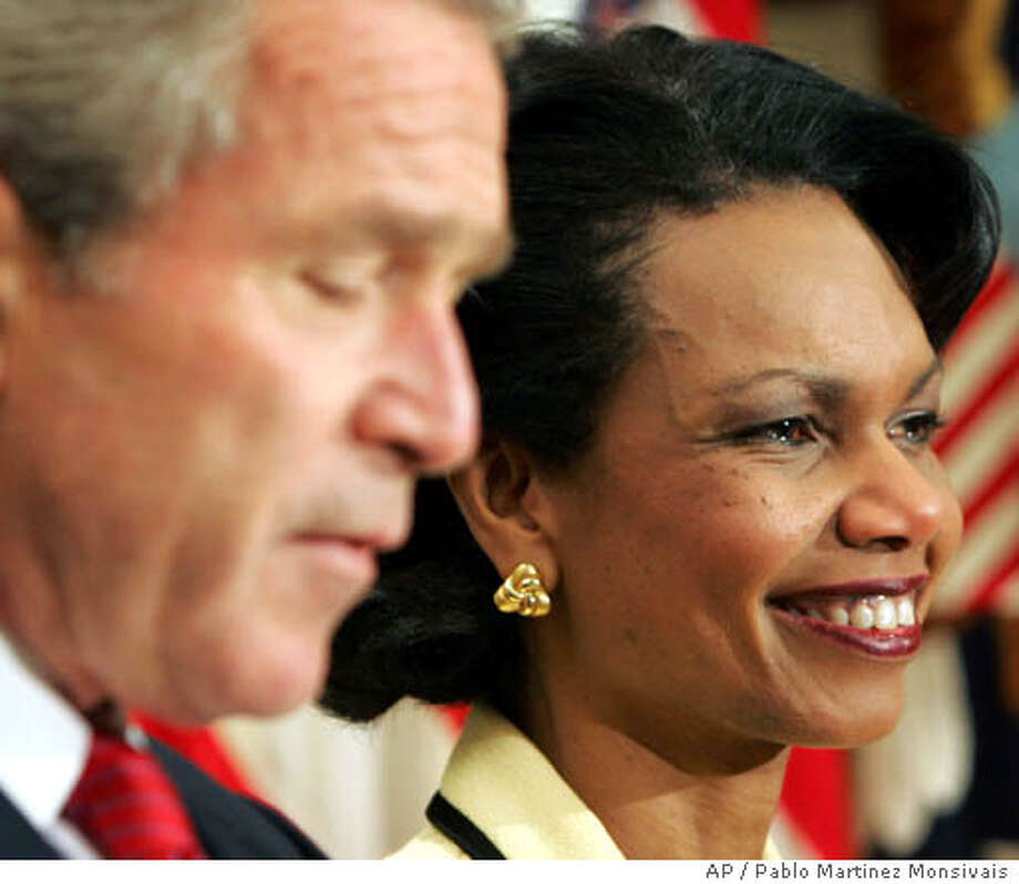 National Security Advisor Condoleezza Rice, right, smiles as President Bush, left, announces that she is his nominee for Secretary of State, in the Roosevelt Room of the White House, Tuesday, Nov. 16, 2004 in Washington. Bush turned to his most trusted foreign policy adviser, Rice, to lead U.S. diplomacy during his second term, replacing current Secretary of State Colin Powell. (AP Photo/Pablo Martinez Monsivais) Photo: PABLO MARTINEZ MONSIVAIS