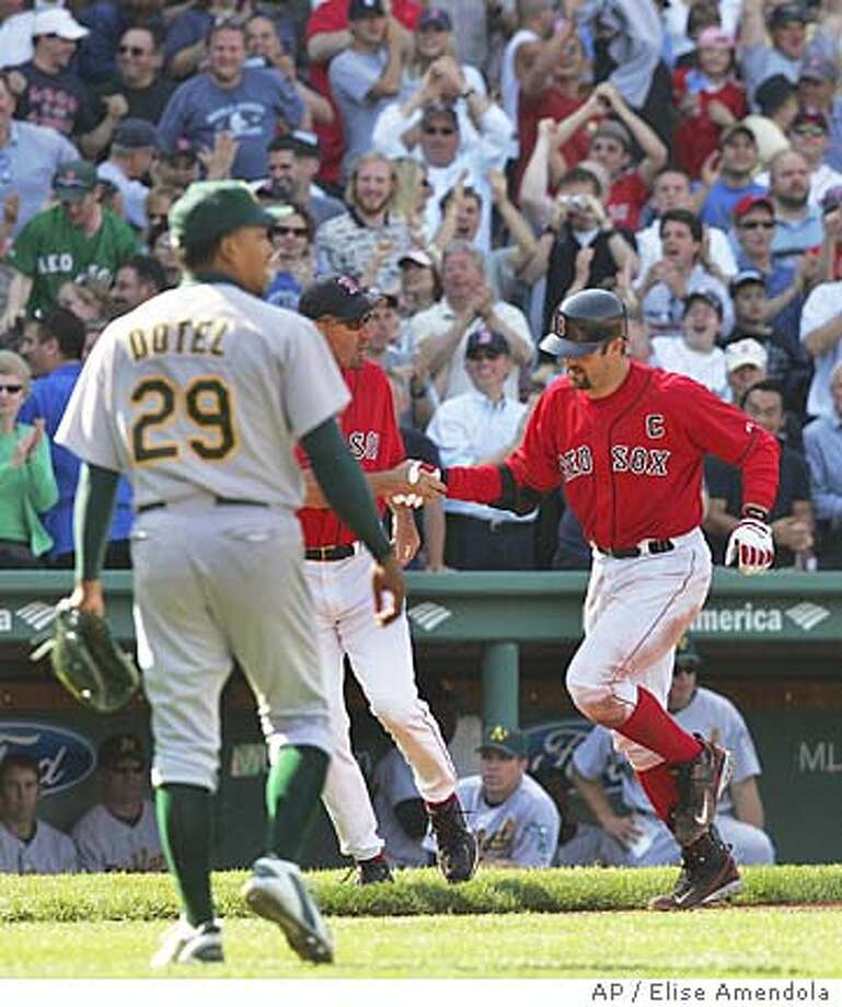 Oakland Athletics relief pitcher Octavio Dotel (29) watches Boston Red Sox' Jason Varitek round third after his two-run homer to beat the Athletics, 6-5, in the ninth inning at Fenway Park in Boston, Wednesday, May 11, 2005. (AP Photo/Elise Amendola) Photo: ELISE AMENDOLA