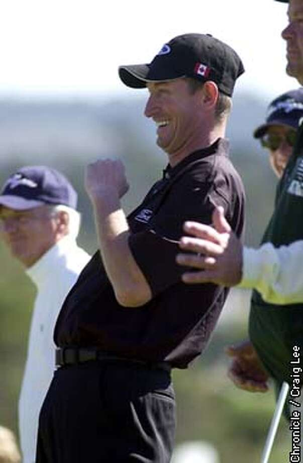 """The AT&T Golf Tournament at Pebble Beach in Carmel, February 8, 2003. Photo of Wayne Gretzky, leans back in excitment after making a putt on the 13th hole at Pebble Beach. Another reason why they call him """"the great one.""""  Photo by Craig Lee/San Francisco Chronicle Photo: CRAIG LEE"""