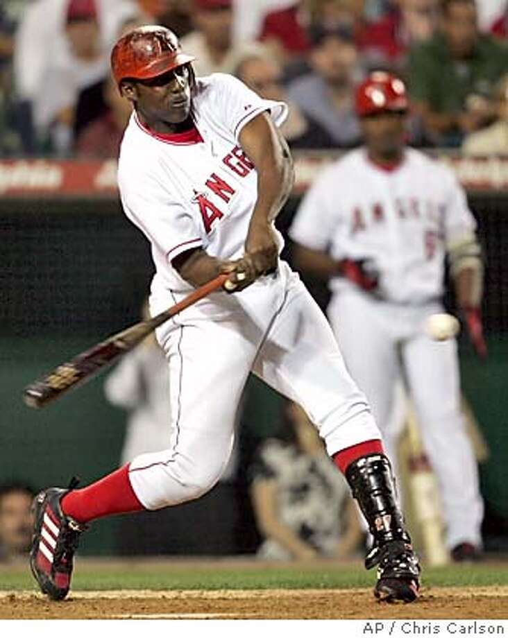 Anaheim Angels' Vladimir Guerrero homers scoring David Eckstein and Chone Figgins against the Boston Red Sox during the sixth inning at Angel Stadium in Anaheim, Calif., on Wednesday, June 2, 2004. (AP Photo/Chris Carlson) ProductName	Chronicle ProductName	Chronicle Photo: CHRIS CARLSON