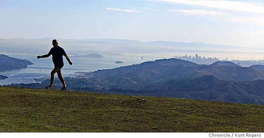 """Walking Don Moseman.On top of Mt Tam overlooking San francisco. He�s walked from Canada to San Francisco and from San Francisco to the Mexican border. At home in Marin, Mount Tamalpais is his sacred hiking ground.A former longtime inmate of San Quentin State Prison, he moved in and out of the big yellow house seven times over a 30-year period on charges ranging from car theft to assault to parole violation.  After his final release 15 years ago, he joined 12-step recovery groups, got clean and sober, and had an epiphany. """"If you don�t break the law, you won�t go to jail,"""" he joked.  Walking Don links his passion for long-distance walking to his years locked up in a smelly, 4-by-8-foot cell. """"Most of my life I spent behind walls in prison,"""" he reflected. """"I love space. I love green. I love the air.""""  Now a popular inspirational speaker in recovery programs, he offers encouragement born of experience to juvenile offenders and recovering addicts and alcoholics. """"My life has become being of service to other human beings,"""" he 11/5/04 in Mill Valley ,CA.  KURT ROGERS/THE CHRONICLE Photo: KURT ROGERS"""