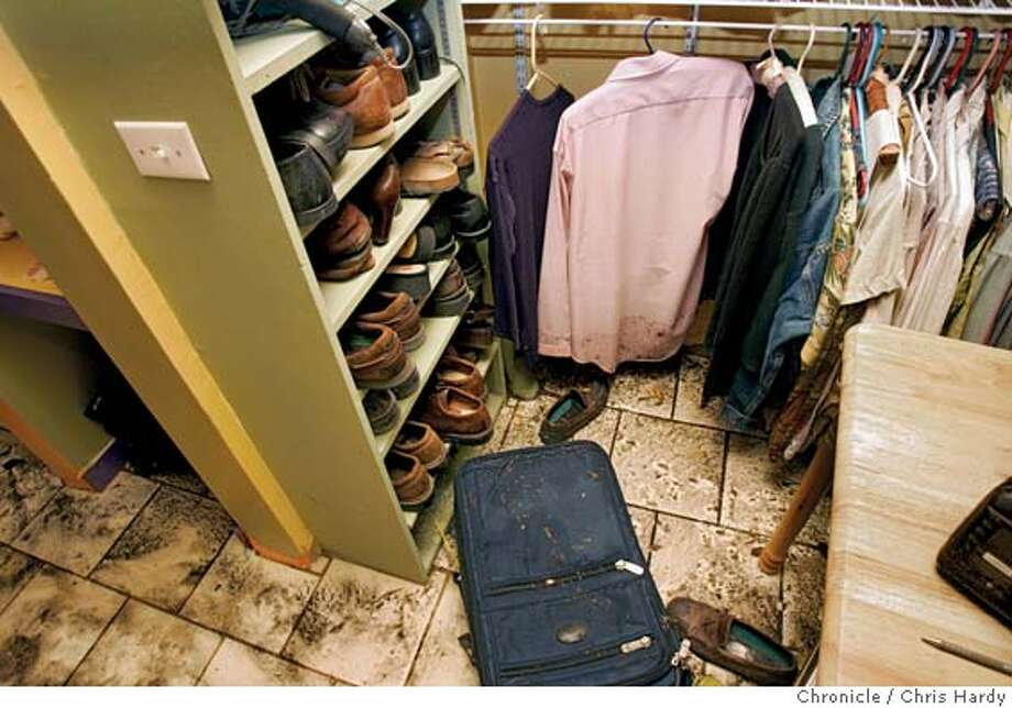 102604_flood_028.jpg  The closet of Paula Bauer and her husband John Lewis' house flooded from overflowing storm drains and ran through their bedroom . San Francisco,CA on 10/26/04  San Francisco Chronicle/Chris Hardy MANDATORY CREDIT FOR PHOTOG AND SF CHRONICLE/ -MAGS OUT Metro#Metro#Chronicle#11/19/2004#ALL#5star##0422433572 Photo: Chris Hardy