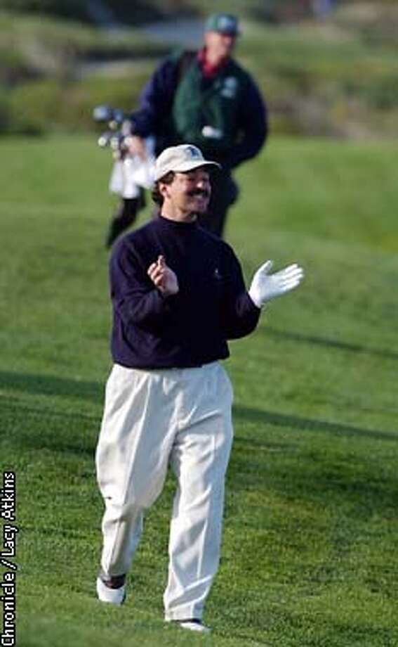 Frank Quattone, claps for his golf partner's shot, as he walks down the fairway at the Spyglass Hill course on the second day of the AT&T Pebble Beach Golf Tournament, Friday Feb.7,2003, in Carmel.  SAN FRANCISCO CHRONICLE/LACY ATKINS Photo: LACY ATKINS