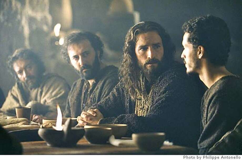 Jesus (Jim Caviezel) sits with the apostles at The Last Supper in a scene from The Passion of The Christ, a film by Mel Gibson. � 2003 Icon Distribution Inc. All Rights Reserved. A Newmarket Films release. Photo credit: Philippe Antonello