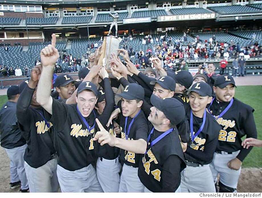 Event on 5/11/05 in San Francisco.  The Lincoln Mustangs, holding up the City Championship trophy, celebrate in SBC Park after their victory over the Washington Eagles.  The Lincoln Mustangs beat Washington Eagles for the San Francisco City Championship at SBC Park.  Liz Mangelsdorf / The Chronicle Photo: Liz Mangelsdorf