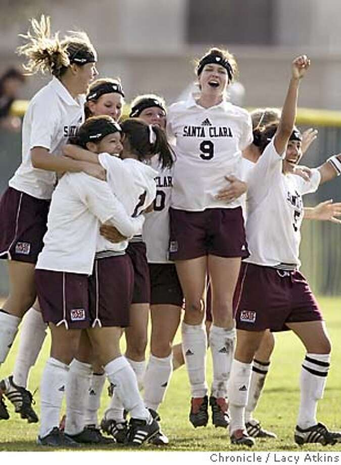 Tina Estrada and Bree Horvath hug as the Santa Clara womens soccer team cheer after defeating the Stanford Cardinals in the NCAA Division 1 Women's Soccer Championship, Sunday Nov. 14, 2004,in Santa Clara. Tina Estrada,(left in hug), is the one who made the goal with Bree Horvath( right in hug) assisting the goal. -----SANTA CLARA PLAYS STANFORD IN THE NCAA SOCCER DIVISION 1 WOMEN'S CHAMPIONSHIP, IN SANTA CLARA, NOV.14, 2004. LACY ATKINS/SAN FRANCISCO CHRONICLE Sports#Sports#Chronicle#11/15/2004#ALL#5star##0422467481 Photo: LACY ATKINS