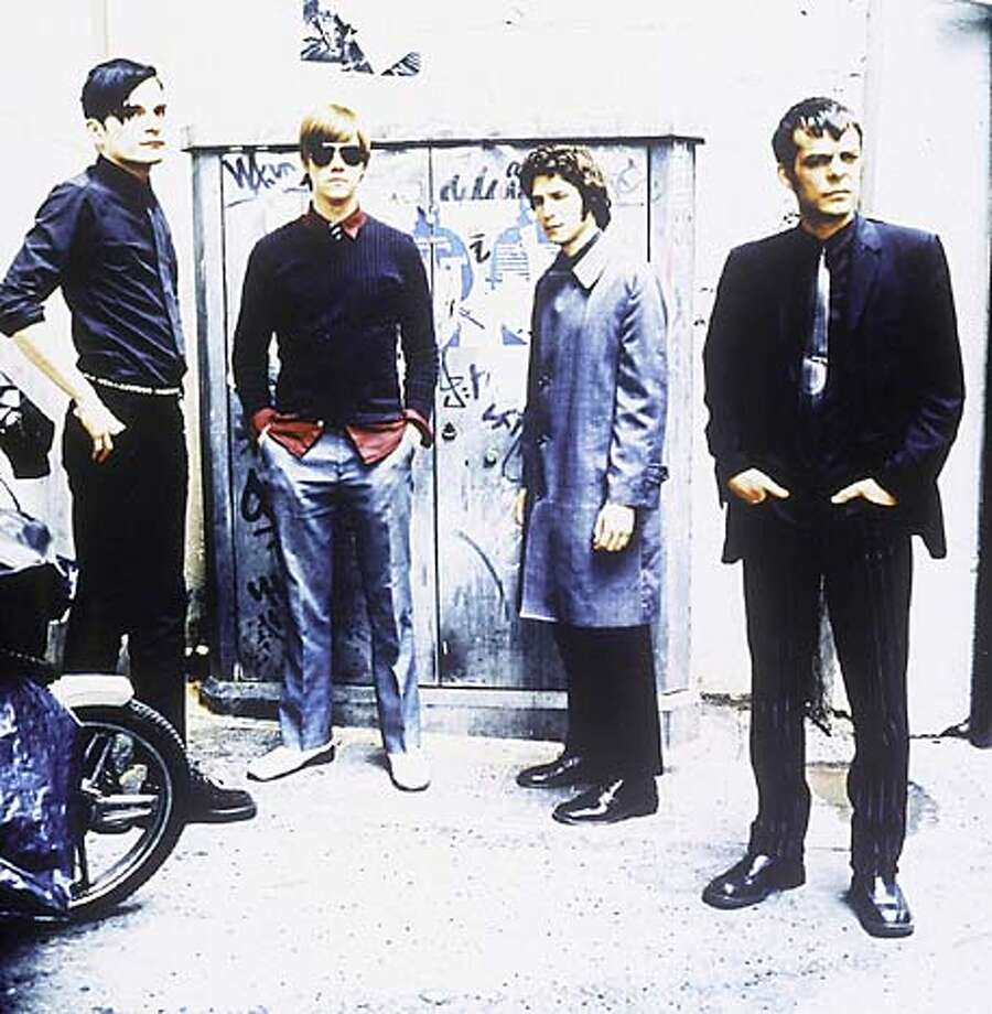 The members of Interpol -- bassist Carlos Dengler (left to right), singer-guitarist Paul Banks, guitarist Daniel Kessler and drummer Sam Fogarino -- are cult stars in Europe.