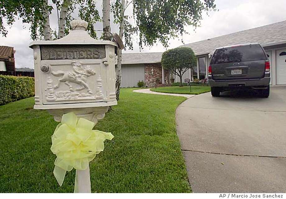 A yellow ribbon hangs from the mailbox outside of Australian engineer Douglas Wood's house in Alamo, Calif., Monday, May 9, 2005. Wood has been kidnapped by militants while working in Iraq. His captors are demanding a pullout of all Australian troops currently in Iraq. (AP Photo/Marcio Jose Sanchez) Photo: MARCIO JOSE SANCHEZ