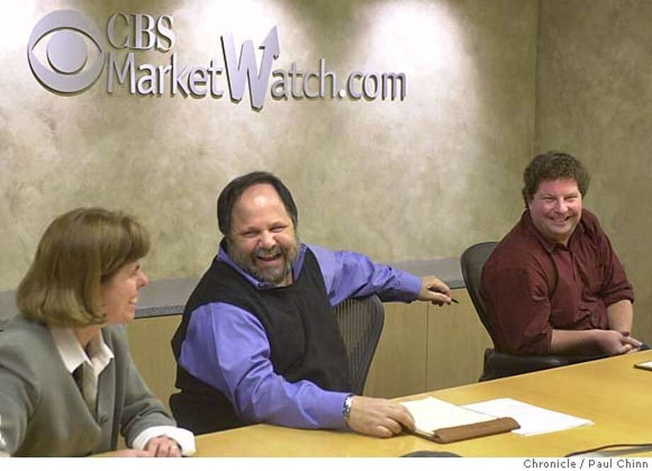 MEDIA09B-C-08JAN02-BU-PC  Larry Kramer (center) shared a laugh with Kathy Yates and Dave Callaway during a planning at CBS Marketwatch.com offices.  PAUL CHINN/S.F. CHRONICLE CAT Business#Business#Chronicle#11/16/2004#ALL#5star##422126258 Photo: PAUL CHINN