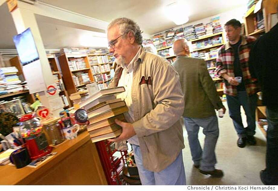 Mystery writer, Michael Kurland, brings a stack of bargain books to the counter, to buy.the San Francisco Mystery Book store, which is celebrating 30 years of peddling whodunnits. Story will also have a sidebar on other specialty bookstores in the Bay Area. Please get atmospheric, mysterious shots of the store (in Noe Valley) and its proprietor Diane Kudisch and her mystery-loving dog. Kudisch is a former customer of the store who took over for the original proprietor. The store is having a 30th birthday party for its customers on Saturday, starting at noon. .CHRISTINA KOCI HERNANDEZ/CHRONICLE Datebook#Datebook#SundayDateBook#11/14/2004#ALL#Advance##0422456787 Photo: CHRISTINA KOCI HERNANDEZ