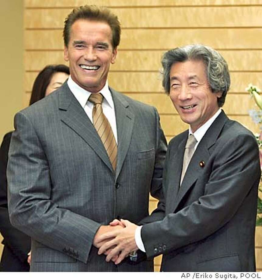 California Governor Arnold Schwarzenegger, left, beams as he meets with Japanese Prime Minister Junichiro Koizumi at the premier's official residence in Tokyo Friday, Nov. 12, 2004. Schwarzenegger met Koizumi and other top Japanese officials during a California trade and tourism blitz in Tokyo, as the governor tries to fill his state's drained coffers by luring business from the world's second-biggest economy.(AP Photo/Eriko Sugita, POOL) POOL Nation#MainNews#Chronicle#11/17/2004#ALL#5star##0422463103 Photo: ERIKO SUGITA