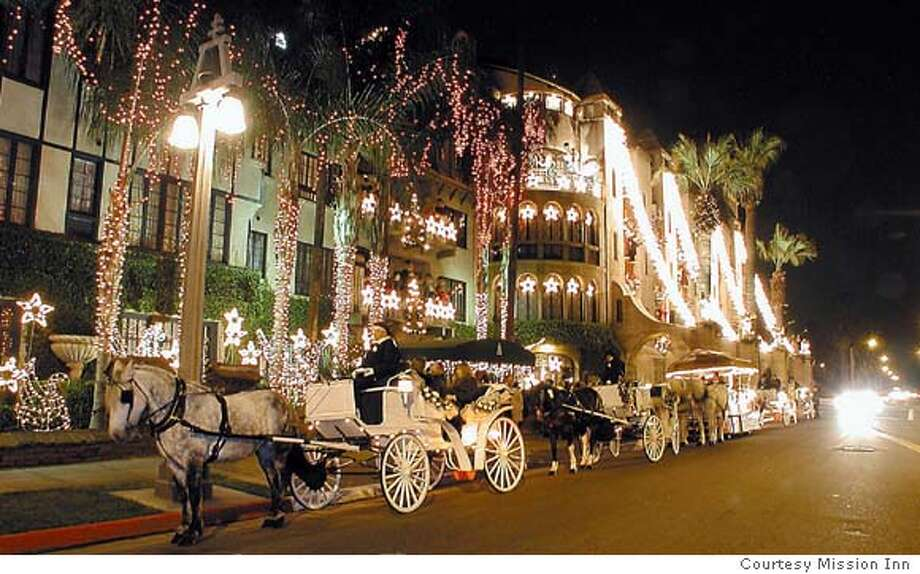 TRAVEL RIVERSIDE Mission Inn -- Riverside's Mission Inn, the darling of presidents and celebrities in its 100 years, has staged a holiday Festival of Lights since it reopened in 1993 after a $55 million renovation. photo credit: Courtesy Mission Inn Travel#Travel#Chronicle#11/14/2004#ALL#Advance##0422462003