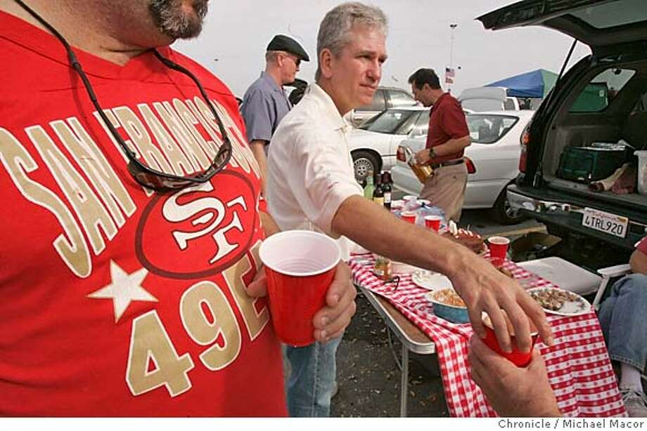 faithfulA_102_mac.jpg Brad Dauer passes out rhe drinks, Al diaz with his (49er shirt on), Larry Giffin, (black beret) and Steve Lefcvzik, (red polo shirt) in background. A look at whether 49er fans are staying faithful, despite the mounting losses, crumbling stadium, detached team owner, and worst season in three decades. We meet up with a group of 49er Faithful at Candlestick Sunday morning, before the game pitting the 49ers against the nfl's other losingest team. Brad Dauer has been a 49ers season ticket holder through thick and thin, wins and losses. He and a group meet before every home game. 11/14/04 San Francisco, CA Michael Macor / San Francisco Chronicle Mandatory Credit for Photographer and San Francisco Chronicle/ - Magazine Out #MainNews#Chronicle#11/15/2004####0422466880 Photo: Michael Macor