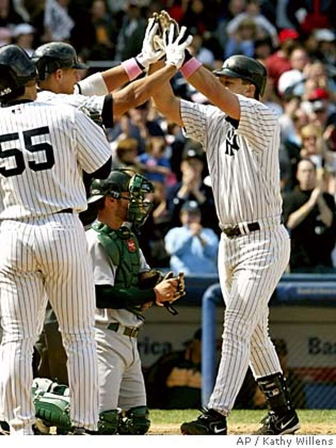 New York Yankees Hideki Matsui, and Alex Rodriguez, from left, greet Tino Martinez at the plate as they celebrate Martinez' three-run eighth inning homer off Oakland Athletics pitcher Kiko Calero, Sunday, May 8, 2005, at Yankee Stadium in New York. Athletics catcher Jason Kendall is on his knees in the middle of the plate. (AP Photo/Kathy Willens) Photo: KATHY WILLENS