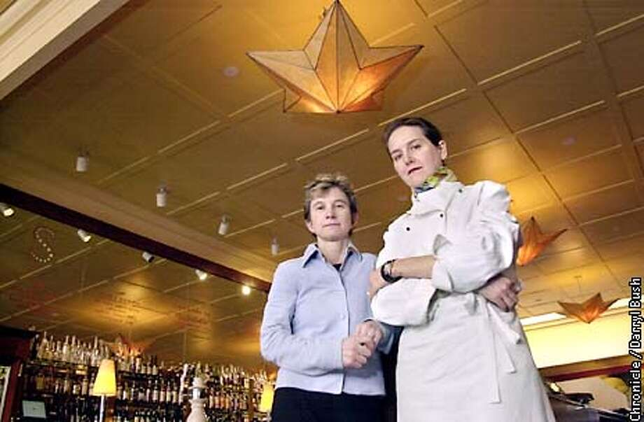 Co-owners Lori Regis (left) and Amaryll Schwetner, stand inside the dining room with the bar and star shaped lights on the ceiling, at Stars restaurant in San Francisco. Stars is due to close. Chronicle Photo by Darryl Bush Photo: Darryl Bush