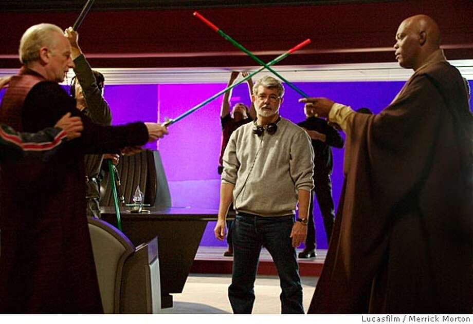 "(NYT21) UNDATED -- April 29, 2005 -- Adv. for Sun., May 1, 2005 -- LIFE-AFTER-STAR-WARS-3 -- George Lucas working behind-the-scenes on ""Star Wars: Episode III Revenge of the Sith,"" with Ian McDiarmid, left, and Samuel L. Jackson. Now that Lucas has finished the last of his six ""Star Wars,"" movies, what will become of his company, Lucasfilm? To hear Lucas tell it, Lucasfilm will be less ambitious, not more. From now on, he said, Lucasfilm will be a ""widget driven"" enterprise, churning out books, video games and television shows. (Merrick Morton/Lucasfilm./The New York Times)**ONLY FOR USE WITH STORY BY LAURA HOLSON SLUGGED: LIFE-AFTER-STAR-WARS. ALL OTHER USE PROHIBITED. XNYZ, **ONLY FOR USE WITH STORY BY LAURA HOLSON SLUGGED: LIFE-AFTER-STAR-WARS. ALL OTHER USE PROHIBITED. Photo: Lucasfilm"