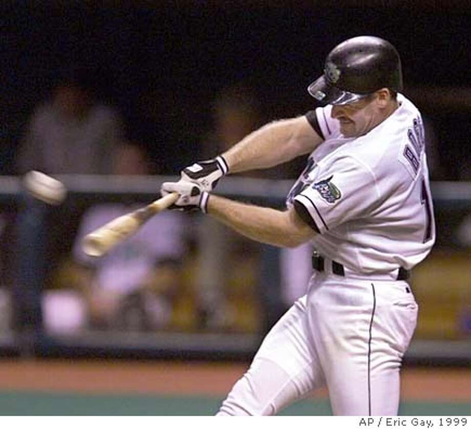 ** FILE ** Tampa Bay Devil Rays' Wade Boggs hits a home run fo his 3000th hit, in the sixth inning against the Cleveland Indians at Tropicana Field in St. Petersburg, Fla., in this Aug. 7, 1999 photo. Five-time AL batting champion Wade Boggs, eight-time All-Star Darryl Strawberry and two-time NL batting champion Willie McGee are among 12 players who will appear on the Hall of Fame ballot for the first time. (AP Photo/Eric Gay) Ran on: 11-30-2004  Wade Boggs got his 3,000th base hit with a home run on this swing for Tampa Bay in his final season. Photo: ERIC GAY
