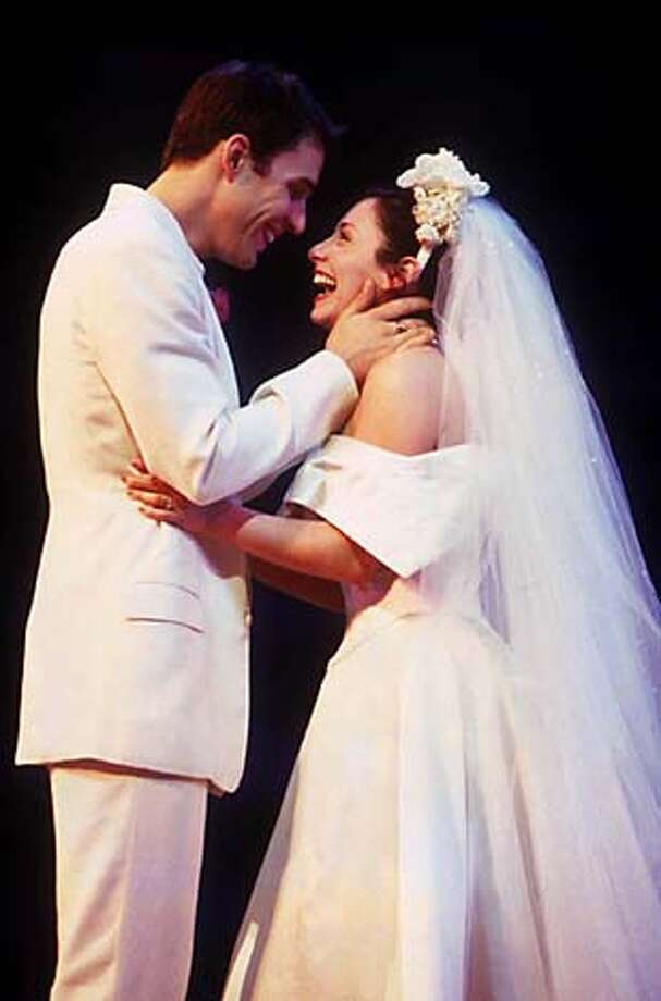 THIS IS A HANDOUT IMAGE. PLEASE VERIFY RIGHTS. MAMMA20-C-19JUN02-DD-HO --- MAMMA MIA!National Tour Ryan Silverman and Michelle Aravena  Photo Credit: Joan Marcus  (HANDOUT PHOTO) Photo: HANDOUT
