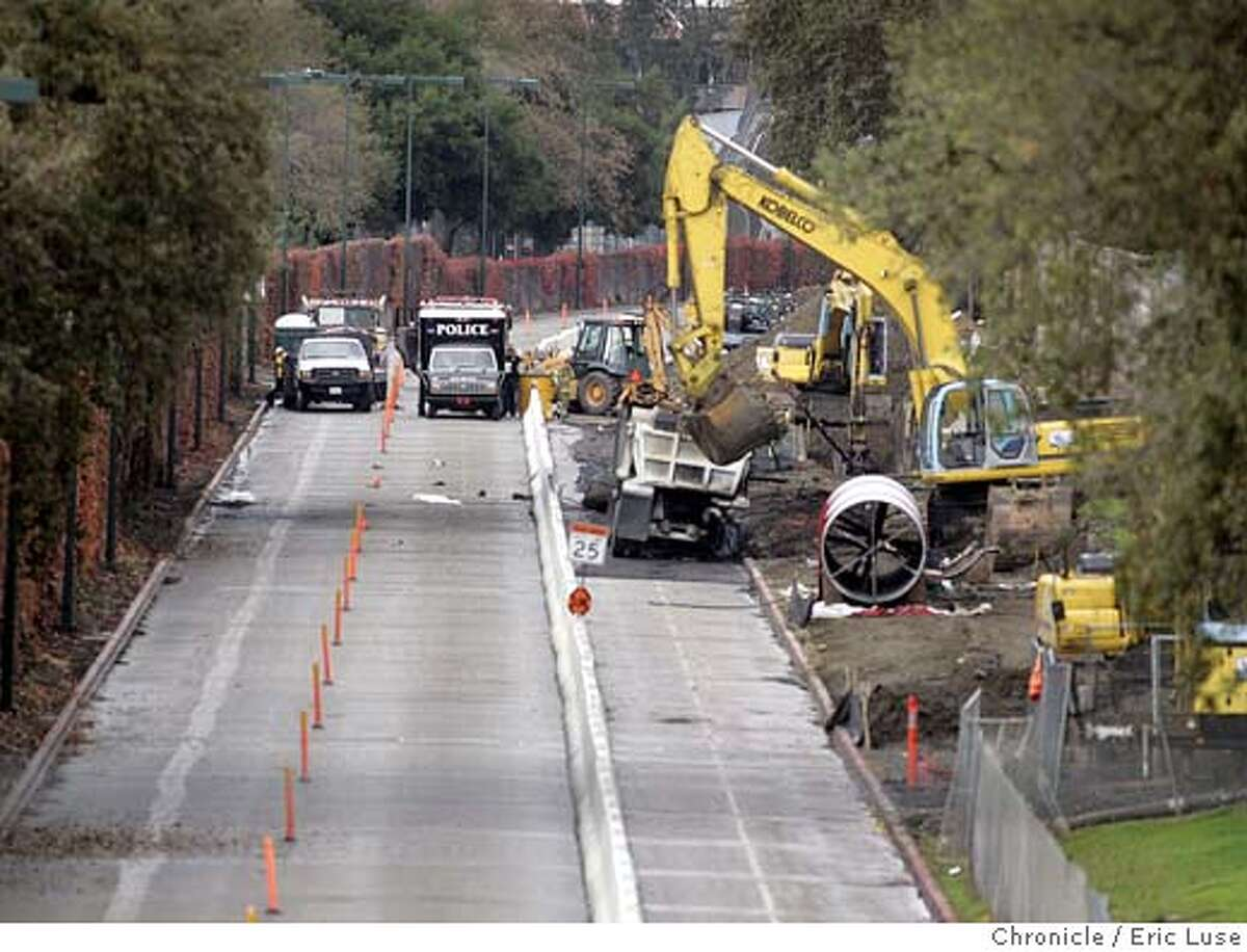 Police officers on Wednesday, Nov. 10, 2004, cordon off the site of a Tuesday explosion in Walnut Creek, Calif. Two people remained missing Wednesday, after an underground fuel pipeline exploded when it was struck accidentally by a construction crew extending a water line. The two missing were part of a construction team that accidentally hit a fuel pipeline. (AP Photo/San Francisco Chronicle, Eric Luse) MAGS OUT MANDATORY CREDIT Metro#Metro#Chronicle#11/13/2004#ALL#5star##0422460631