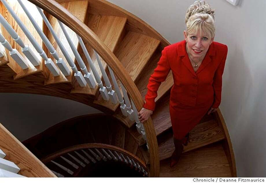 Jeannie Anderson is a Real Estate agent with Pacific Union. She is on a stairway in a home that she just sold in Eureka Valley.  San Francisco Chronicle photo by Deanne Fitzmaurice Photo: Deanne Fitzmaurice
