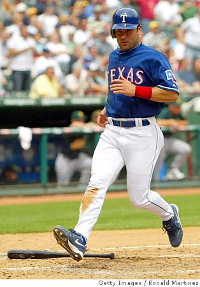 ARLINGTON, TX - APRIL 19: David Dellucci #22 of the Texas Rangers scores a run against the Oakland Athletics on April 19, 2005 at Ameriquest Field in Arlington in Arlington, Texas. The Rangers defeated the A's 3-0. (Photo by Ronald Martinez/Getty Images) *** Local Caption *** David Dellucci Ran on: 05-01-2005  David Dellucci's .492 on-base percentage would be second-best in the AL if the Texas outfielder had four more plate appearances to qualify among the leaders. Photo: Ronald Martinez