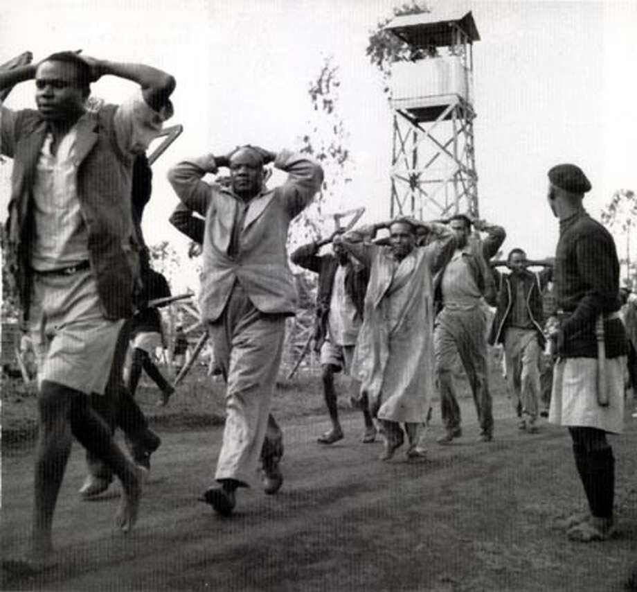 "Caption from the book""Histories of the Hanged: The Dirty War in Kenya and the End of Empire"" (Norton): ""Kikuyu suspects rounded up during Operation Anvil are marched into the interrogation camp at Langata.""  FOR USE WITH BOOK REVIEW ONLY"