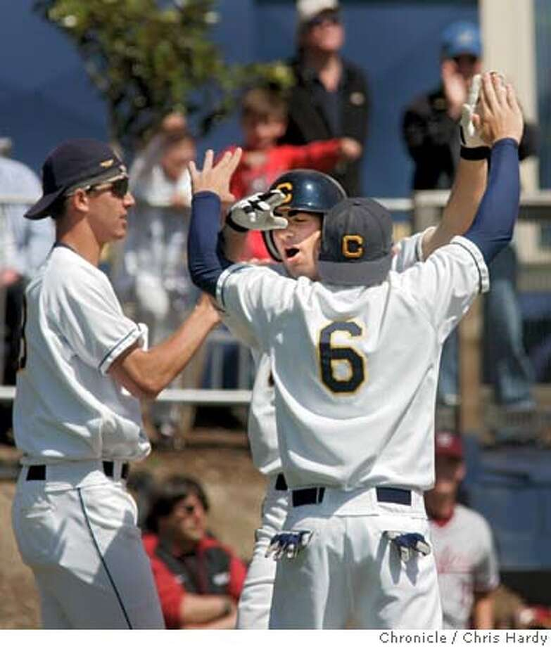 collbaseball08_ch_106.jpg  Cal's Josh Satin gets high fived by Kyle Spraker after Satin scored tying run in the 10th inning  College baseball: Stanford at Cal in Berkeley  5/7/05 Chris Hardy / San Francisco Chronicle Photo: Chris Hardy