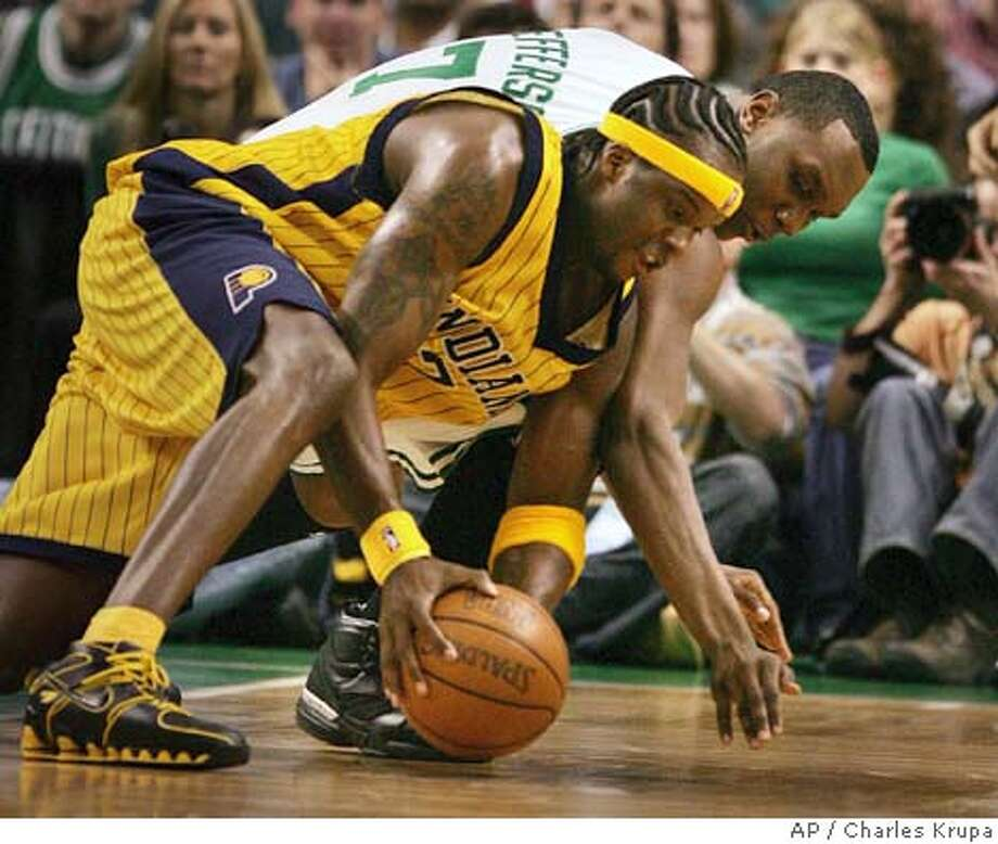 Indiana Pacers, forward Jermaine O'Neal, left, and Boston Celtics forward Al Jefferson dive for a loose ball during game seven of the first round of the NBA Playoffs in Boston, Saturday evening, May 7, 2005. (AP Photo/Charles Krupa) Photo: CHARLES KRUPA